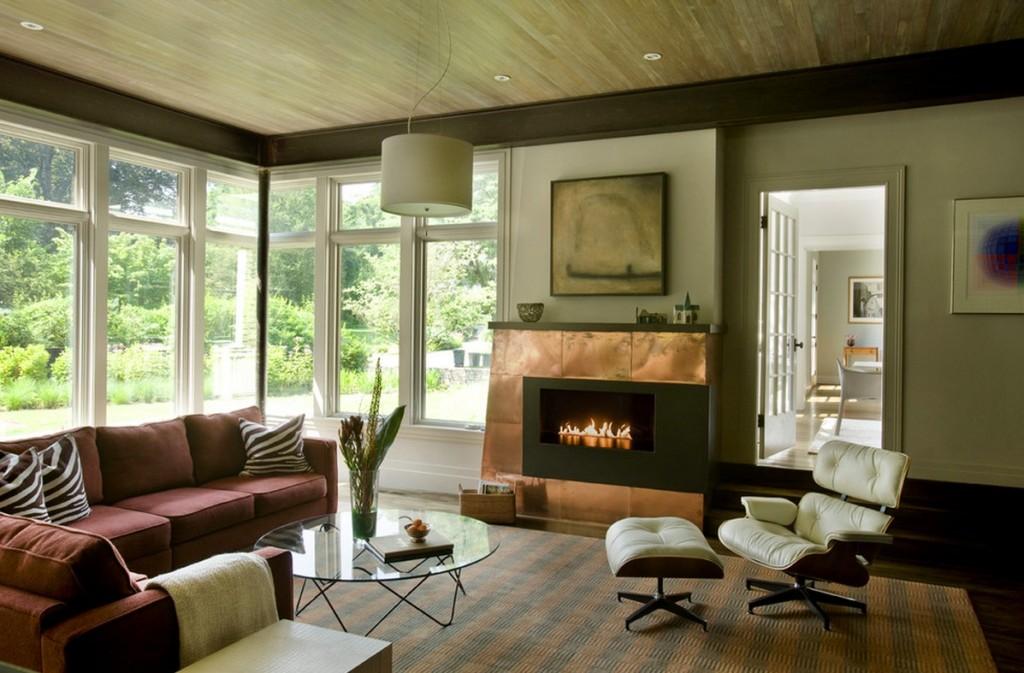 Дизайн интерьера гостиной в колониальном стиле. отделка камина медью